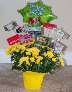 Gift Card Flower Pot: insert all those random lower value gift cards that were donated into a flower pot with card holder sticks.