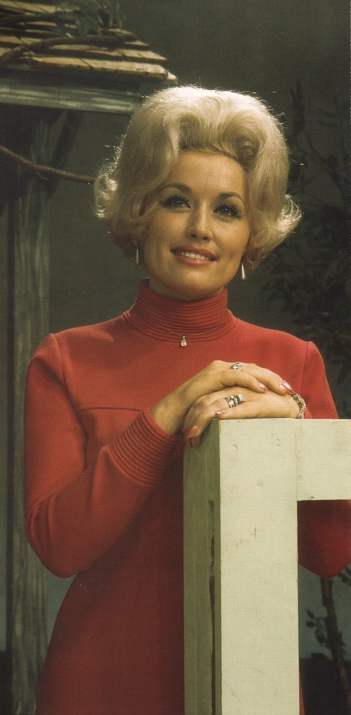 Dolly in the 1960's. The infamous blonde wig is already there, but as yet she hs not succumbed to plastic surgery on her chest. Dolly, why did you ever do it?
