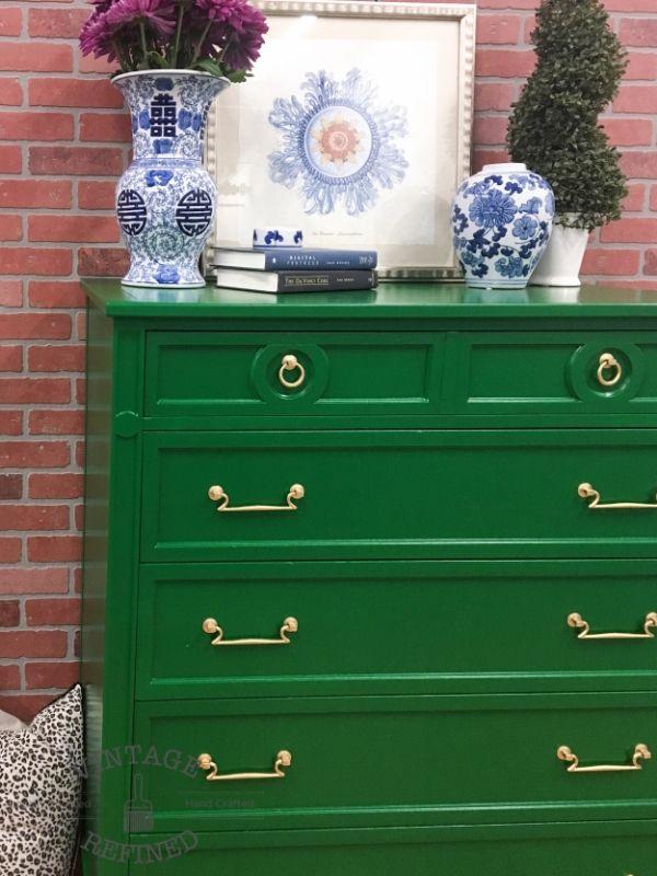 Emerald Milk Paint by General Finishes.  Spray gun plus polyurethane coat.