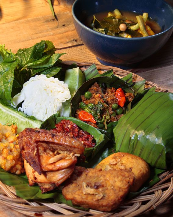 Nasi Timbel Komplit. Indonesian cuisine and yummy street food favorites