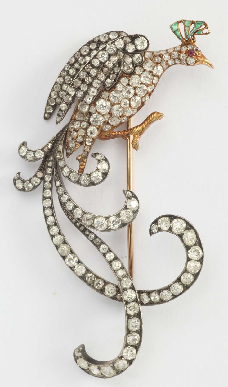 Brooch depicting a bird of paradise with old cut diamonds, rubies and emeralds mounted in gold and silver