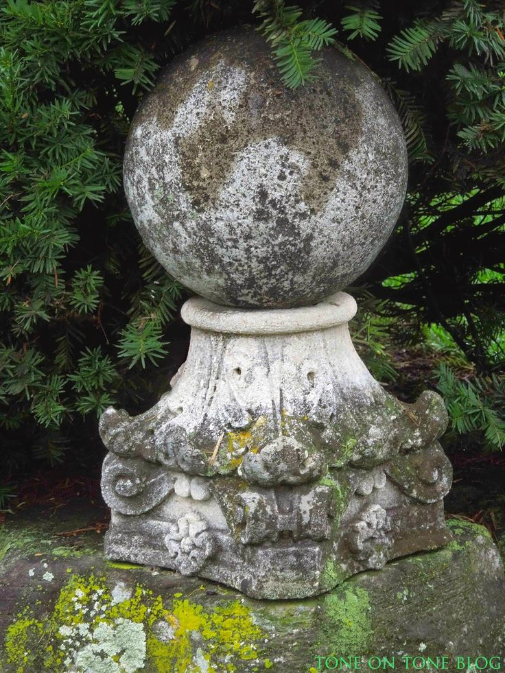 """""""Both the armillary sphere and stone finial create focal points."""""""