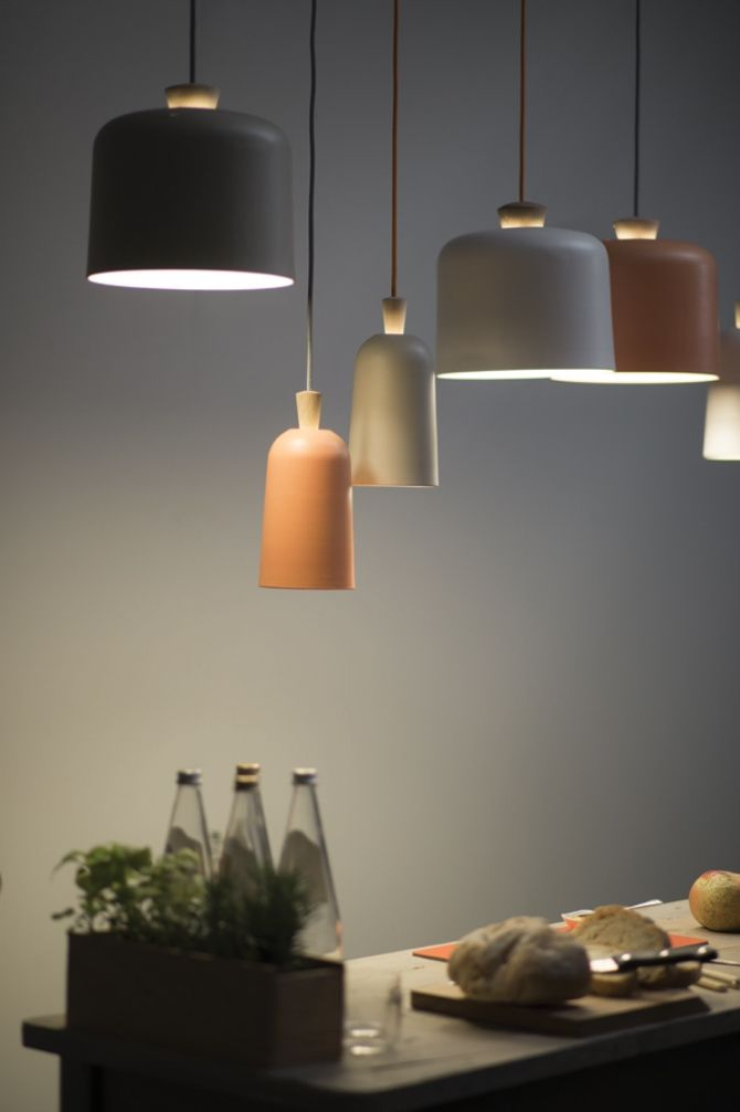 Fuse pendant lights by Note Design studio for Ex.t. The shades are porcelain, held by a wooden structure. Two sizes and three colours.