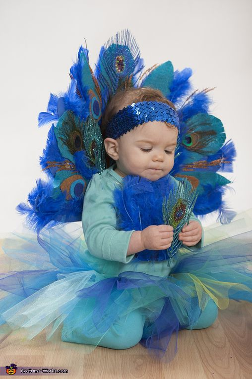 Shannon: This is our baby girl Tessa Skye, who is 11months old, as a peacock - her first Halloween. The costume is entirely handmade, except for the mask, which was only...