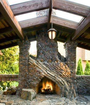 Outdoor mixed stone fireplace on flagstone patio