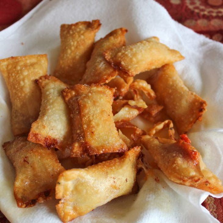 Homemade Pizza Rolls Recipe Appetizers with egg roll wrappers, shredded mozzarella cheese, pepperoni slices, garlic, dried basil, dried oregano, pizza sauce, vegetable oil