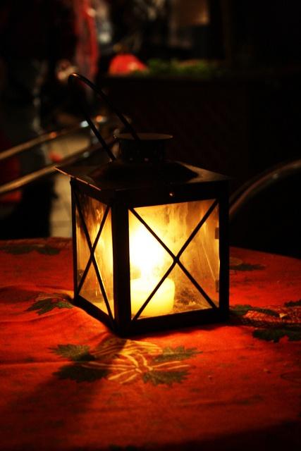 By lantern light...
