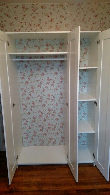 I wallpapered the back of this Ikea Brimnes wardrobe to add some vintage charm. Ikea hacks vintage decor.