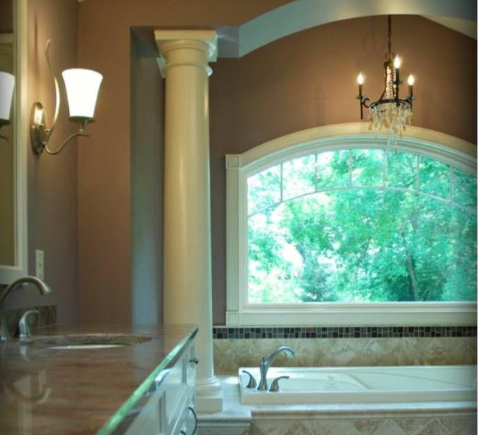 Pillars and ceramic tile around garden tub bathroom for Garden tub bathroom ideas