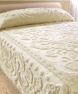 chenille bedspread - my grandma always had one, with her multi-colored black-trimmed crocheted afghan folded at the foot of the bed