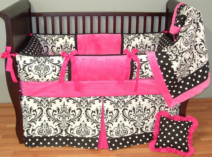Aimee Baby Bedding  This custom 3 pc baby crib bedding set includes a luxury plush bumper pad, tailored kick pleat crib skirt, and so soft minky edged and backed blanket.  The black and white damask and coordinating polka dots, bright pink grosgrain ties, and ultra soft bright pink minky combine softness and textured detail. Top quality and a modern touch for your little angel's nursery.