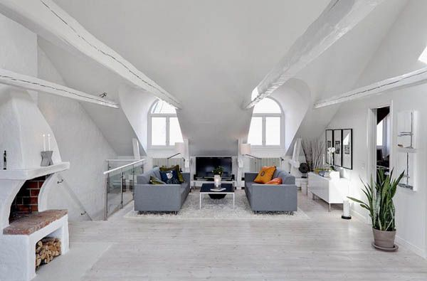 Light-Pierced Attic Crib Overlooking Stockholm Rooftops