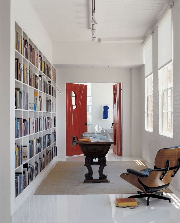 Red doors provide a bold entryway in