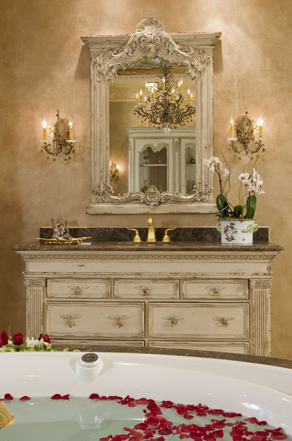 """Your home should envelop you in luxury every time you step through the door. That's especially true with the master bath,"" says Haleh, pointing to the Habersham custom vanity and mirror designs she chose for the space. If you look in the mirror you'll get a glimpse of the Habersham Bibilotheque that is also part of the master suite."