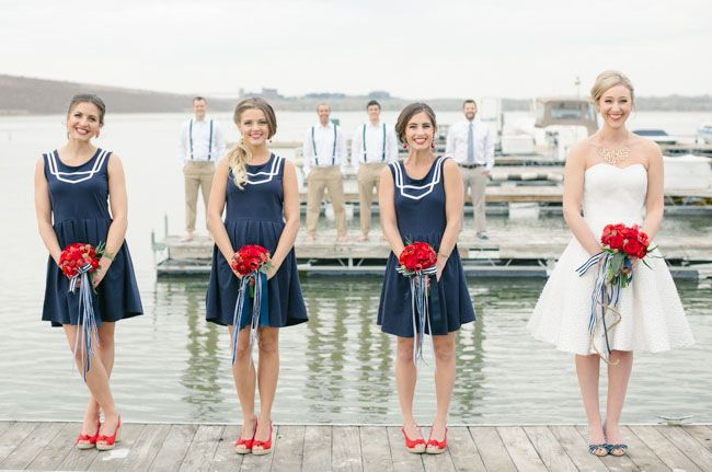 Nautical Wedding Inspiration - love the bridesmaids in blue with the red bouquets!