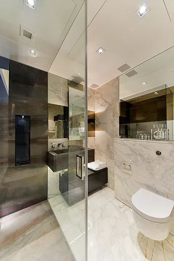 Eramosa Chocolate & Calacatta Oro marble bathroom by Macassar Properties - London investment and development company