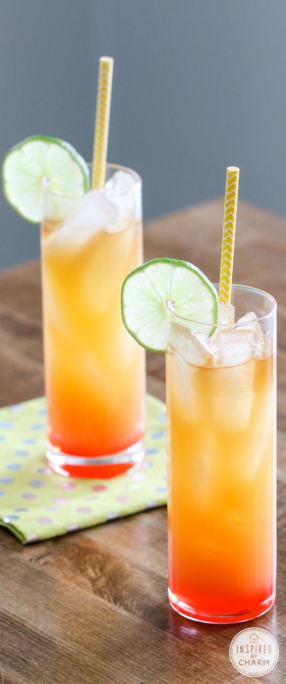 Rum Punch: Pineapple Juice, Orange Juice, Dark Rum, Coconut Rum, Grenadine, Lime Slice.