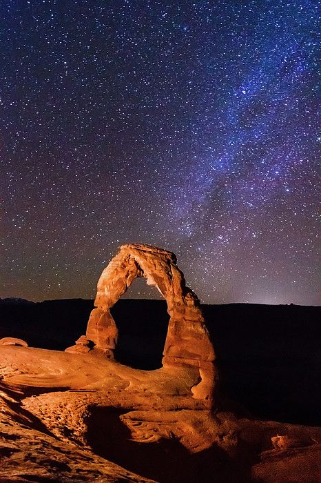 Delicate Arch and Milky Way in the southern sky, Arches National Park, Moab, Utah.