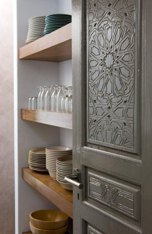 Moroccan inspired kitchen ceramics and beautiful carved door    @pattonmelo