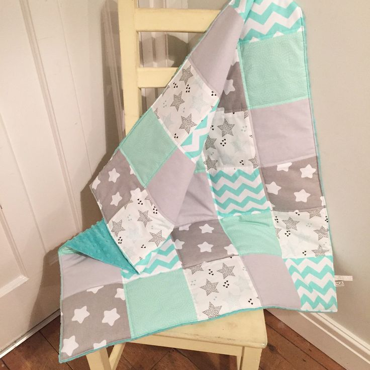 Brand new design stars patchwork baby blanket in lovely shades of grey and aqua. Matching storage baskets and pram liners also available.