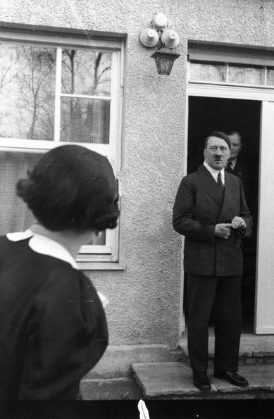 January 5, 1936 with Erna Hoffman looking at him, Obersalzberg (but not the Berghof). This is most likely an Eva Braun photo but it's attributed to Hoffmann. (via putschgirl)
