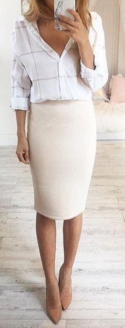 Chic. Stylish white checked blouse with cream pencil skirt