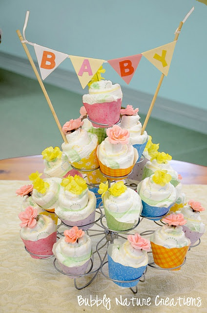 Diaper cakes and cupcakes are so cute and could totally be done with cloth…