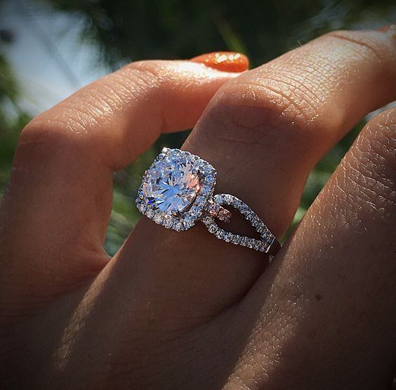 Disney Inspired Rings with a halo engagement ring from Simon G. Pink diamonds and white diamonds in white gold.