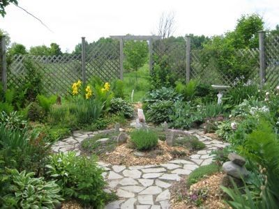 We like rustic fences; variations between areas of a garden; low herb and vegetable garden within fence  taller orchard with fruit trees beyond; a sense of abundant health and life.