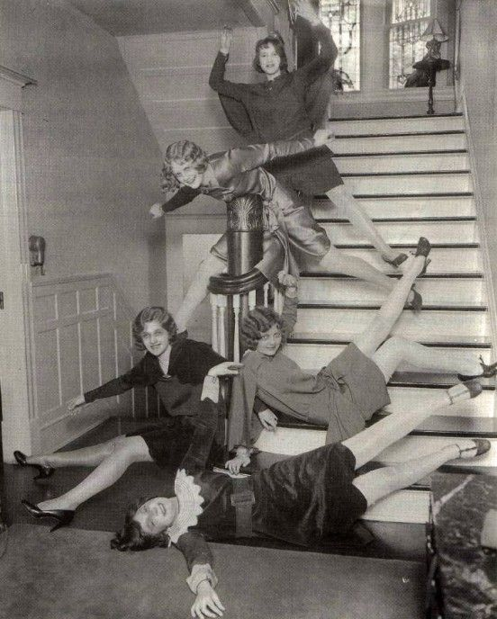 c. 1920s : Girls having fun on stairs