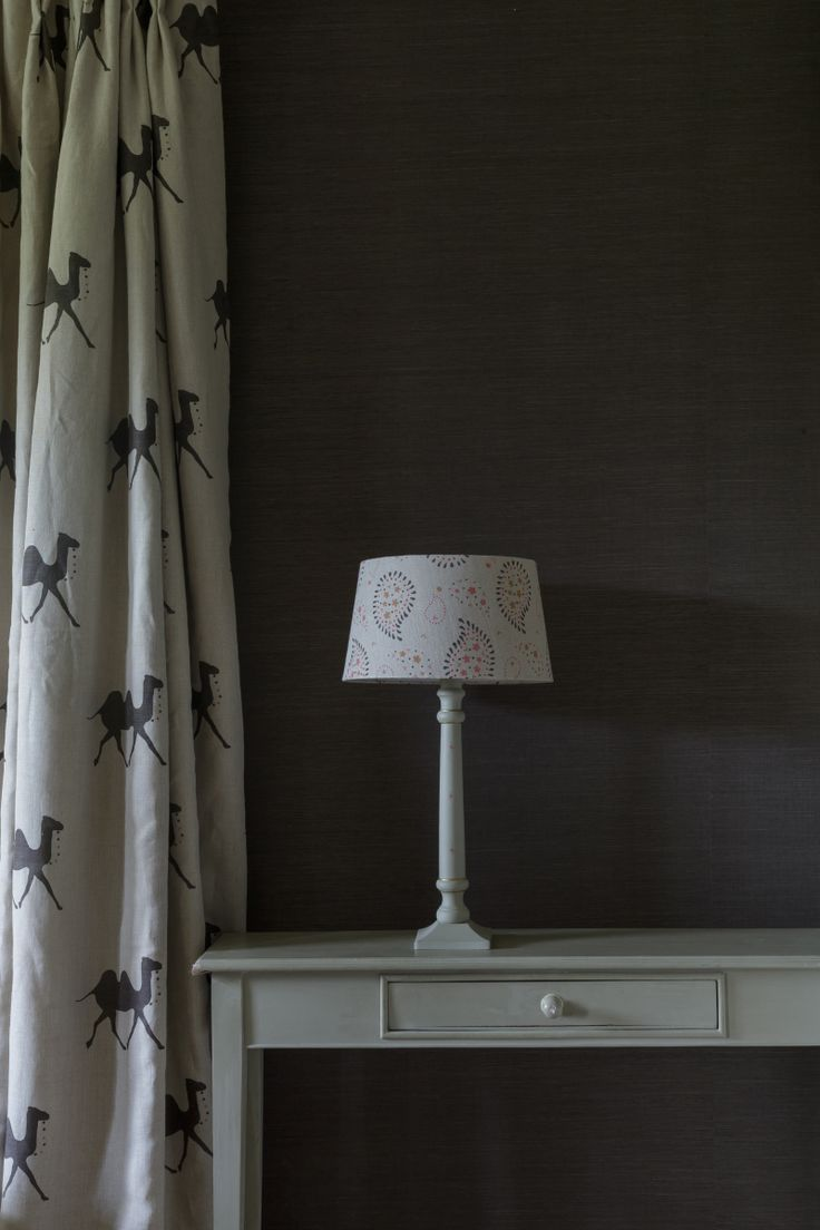 Get the Indian Summer look with a sophisticated palette of graphite teamed with linen pushkar fabric and lullaby lampshade.