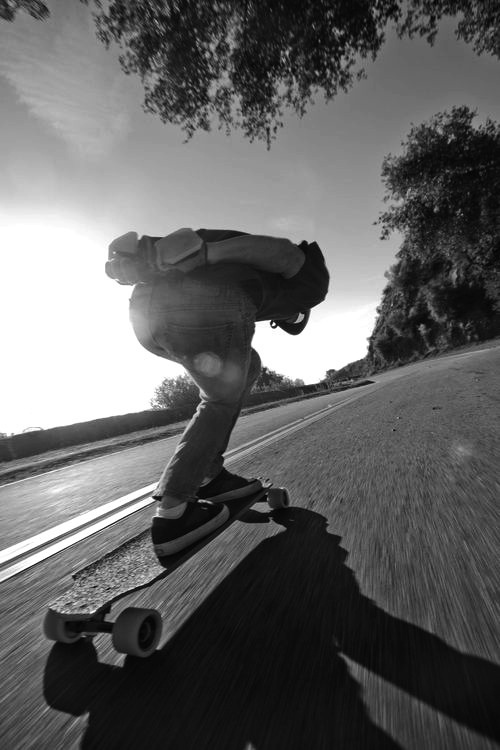 love this video. where the guys longboard with a car on the street. amazing and beautiful in a way.