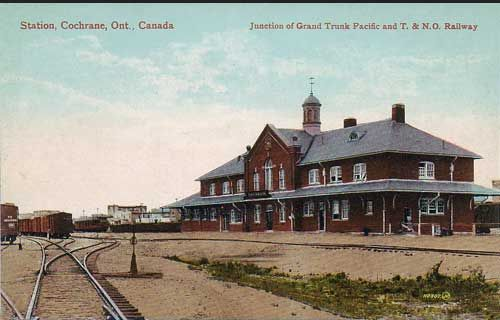 COCHRANE, Ontario - Temiskaming & Northern Ontario and Canadian Nationa Railways junction unionj train station - vintage pc