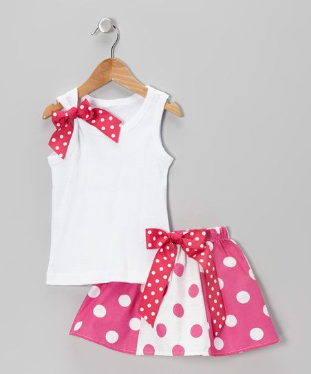 Slip a little lady into this sweet summery set when she feels like skipping around the backyard in style. The comfy cotton tank boasts a playful bow on the strap, while the skirt features a playful mix of prints and an elastic waistband for a snug fit.