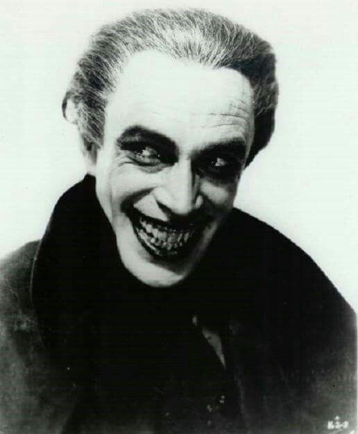German actor Conrad Veidt.  He was the inspiration to the creators of Batman for the Joker with his portrayal of the character Gwynplaine in the 1928 film The Man Who Laughs.