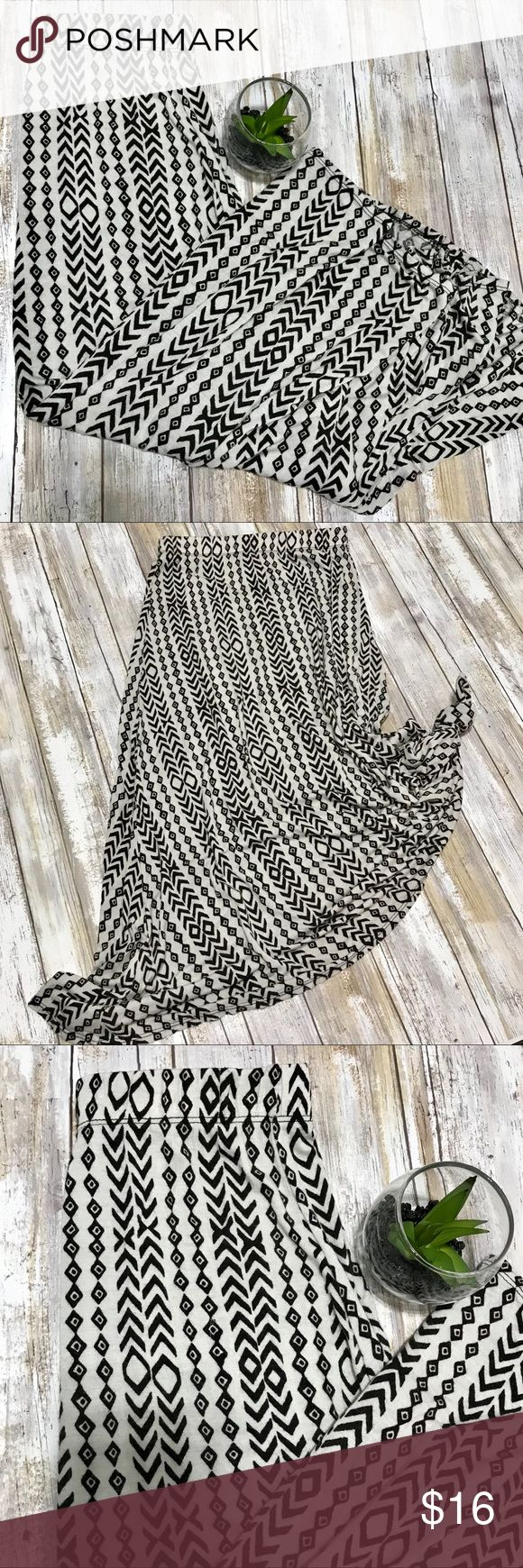 ‼️Lularoe Kids Size 10 Maxi Skirt. TRIBAL‼️ A1 19 Lularoe Kids Size 10 Maxi Skirt  Tribal print. Cream backdrop w all black tribal design! Super cute!! And it's beyond soft and stretchy!!! Super comfortable!! Feels like Leggings material!!  Great Condition. 1' Elastic waistband  Length 30'  A1 19 LuLaRoe Bottoms Skirts