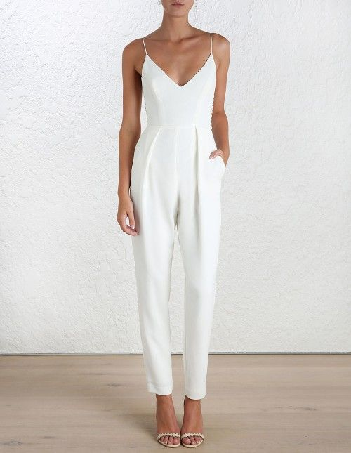 classic and dressy white jumpsuit and minimalist white heels