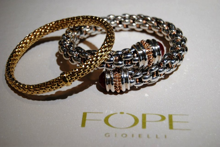18K yellow gold Flex'IT Solo bracelet. Palladium & 18K rose gold Twin criss-cross bracelet with Apricot Moonstone both by designer Fope