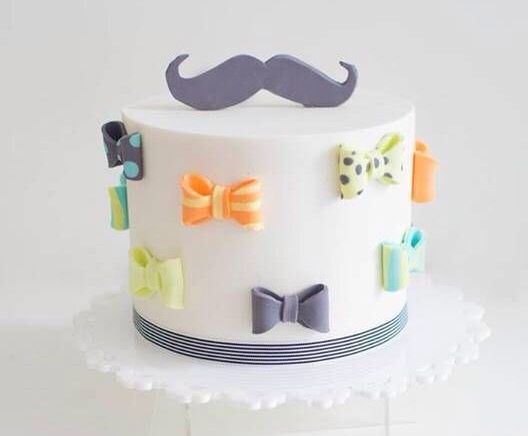 Moustache and bow tie cake