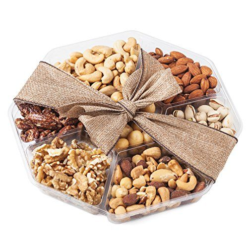 Nutty New Yorker Gourmet Food Nuts Gift Basket, 7 Different Nuts Including Macadamia Nuts - 19.8 Ounces - Kosher Certified ✅ WHOEVER RECEIVES THIS NUT GIFT BASKET WILL ABSOLUTELY LOVE IT, OR YOU GET A FULL REFUND! - If your recipient doesn't love this healthy snacks gift basket, you will get 100% of your money back. We invite you to test us on that. Please check our feedbacks and you will know this is a promise we keep! ✅ 7 DIFFERENT PREMIUM NUTS - Our heart healthy gift