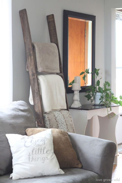 Keep something snuggly on hand for when the living room gets chilly. Bonus: A rustic ladder adds much-needed texture to the room. See more at Love Grows Wild »