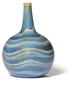 A ROMAN 'MARBLED' BLUE AND WHITE GLASS FLASK FIRST HALF OF 1ST CENTURY A.D. With undulating bands of blue and opaque white wound around the spherical body and up into the tapering neck 4 in. (10 cm.) high