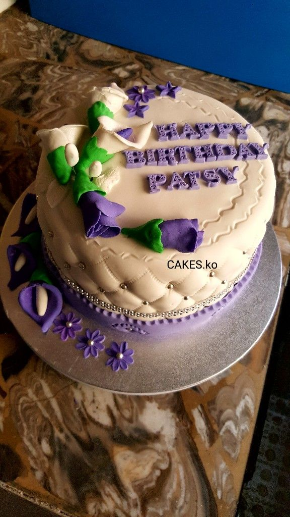 Beautiful lilac and white Birthday cake. Click link to my business page for more of my work.