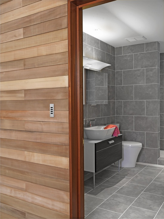 large grey tile on walls and shower surround