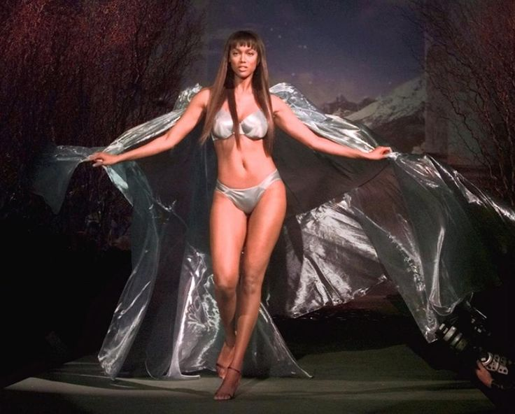 Tyra Banks was a gorgeous force to be reckoned with as she hit the Victoria's Secret runway in 1999, wearing a satin bikini and matching cape that billowed behind her as she posed for cameras.