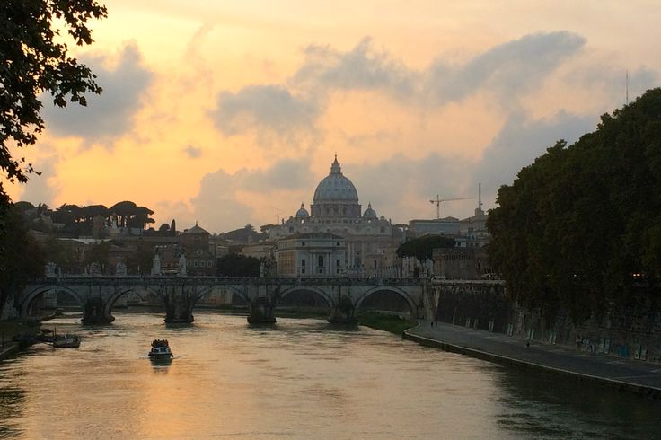 View of Saint Peters Basilica from bridge on the Tiber river.