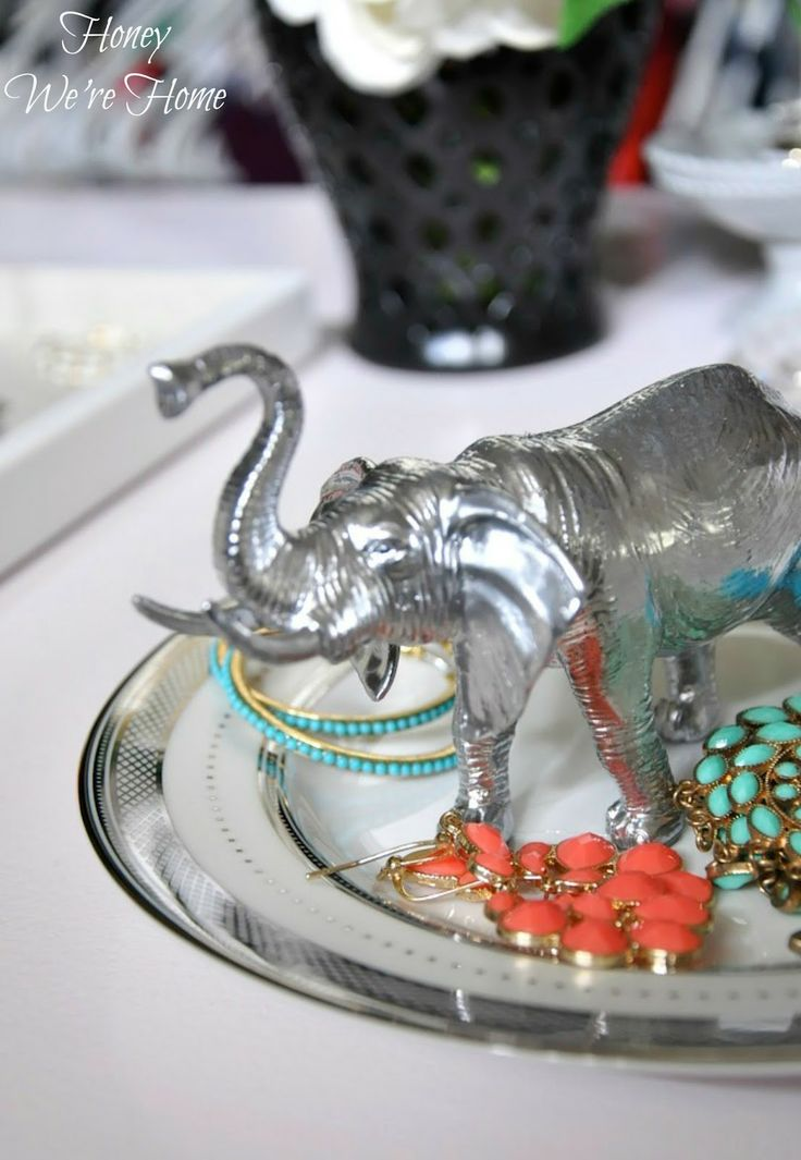 DIY Animal Jewelry Holder from Honey We're Home (using saucers, plastic animals from dollar store, spray paint, and hot glue)