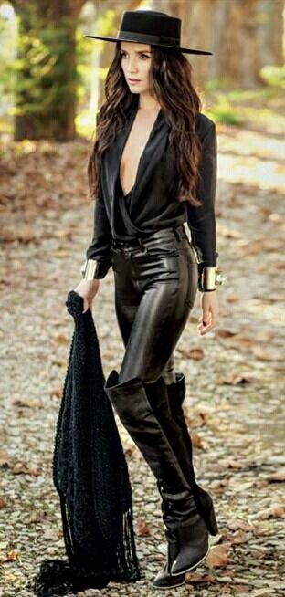 Argentine Model Natalia Oreiro is Wearing Knee-High Jack Boots (Cowboy Style), Black Leather Pants, Black Blouse, Black Boss of the Plains Hat, & Black Bolero Jacket.