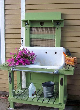 An old door turned into a potting bench. How cool is that!  I have an old green sink...