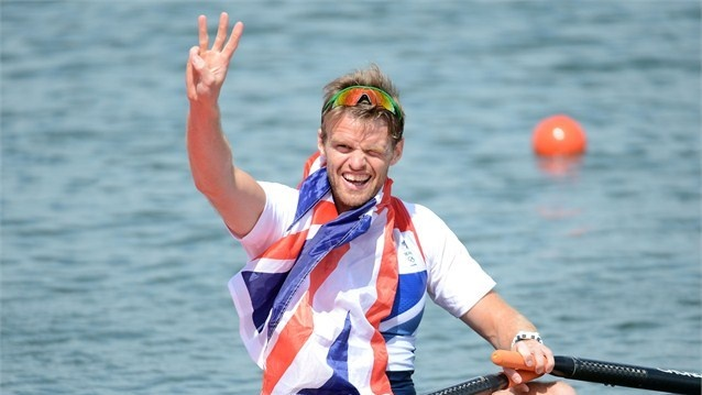Alan Campbell of Great Britain celebrates in his boat with his bronze medal during the medal ceremony for the Men's Single Sculls final on Day 7 of the London 2012 Olympic Games at Eton Dorney